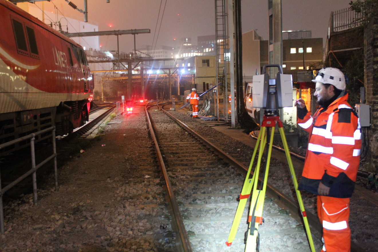 Railway worker working on survey on trackside